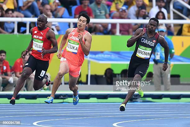 Swaziland's Sibusiso Matsenjwa Japan's Shota Iizuka and Canada's Aaron Brown compete in the Men's 200m Round 1 during the athletics event at the Rio...