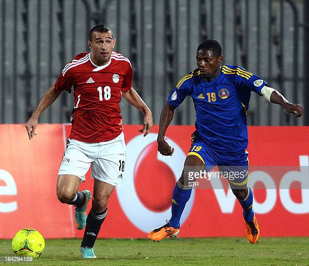 Swaziland's Wonder Nhleko challenges Egypt's Ahmed Temsah during their friendly football match in the Egyptian coastal city of Alexandria on March 22...