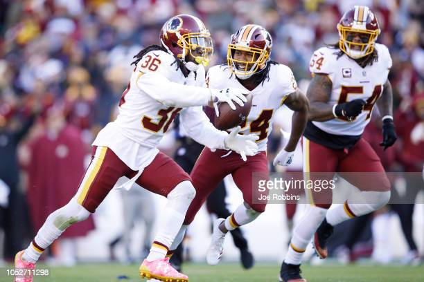 J Swearinger of the Washington Redskins celebrates with Josh Norman after recovering a fumble in the first quarter of the game against the Dallas...