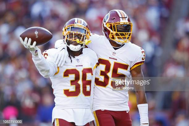 J Swearinger of the Washington Redskins celebrates with Montae Nicholson after recovering a fumble in the first quarter of the game against the...