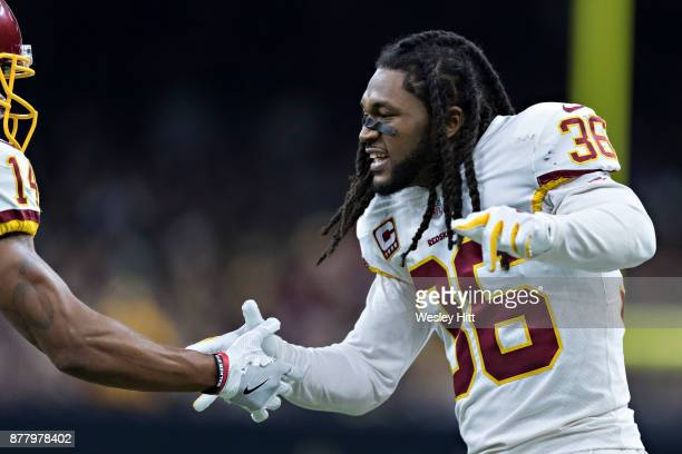J Swearinger of the Washington Redskins celebrates with teammates after a touchdown during a game against the New Orleans Saints at MercedesBenz...