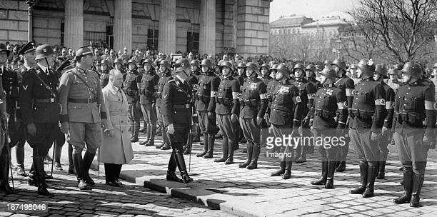 Swearingin of the Austrian police on Heldenplatz Reinhard Heydrich and Heinrich Himmler walk down the front Heldentor/Heldenplatz Vienna March 15th...