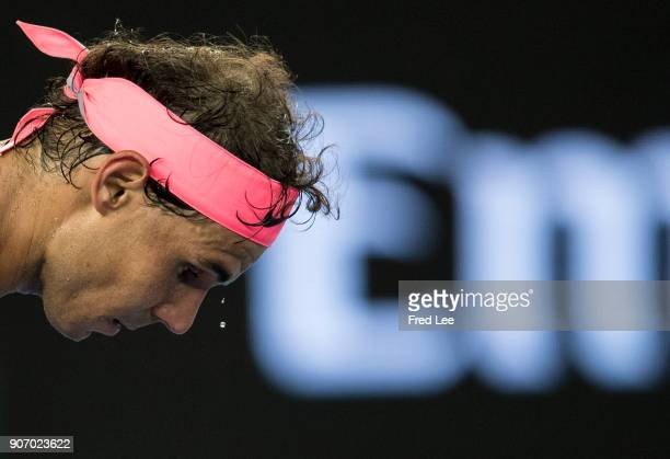 Sweat drips off Rafael Nadal of Spain as he prepares to serve in his third round match against Damir Dzumhur of Bosnia and Herzogovina on day five of...