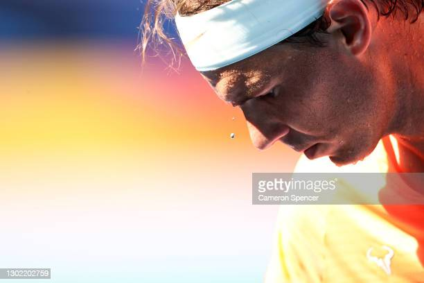 Sweat drips off the forehead of Rafael Nadal of Spain in his Men's Singles fourth round match against Fabio Fognini of Italy during day eight of the...