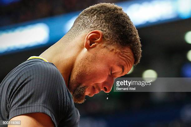 Sweat drips off Warriors' guard Stephen Curry as he heads to the bench after crashing his face hard onto the floor in 1st half action Toronto Raptors...