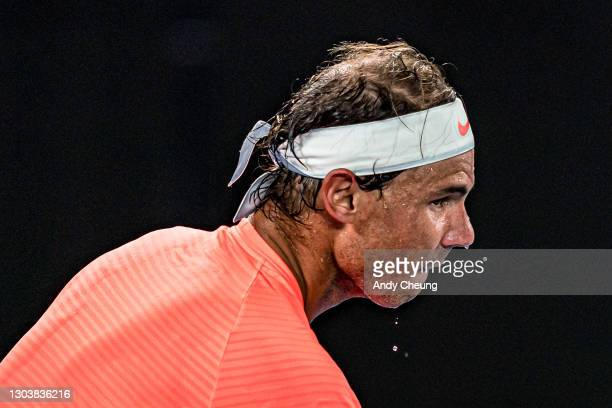 Sweat is seen dripping from Rafael Nadal of Spain during his Men's Singles Quarterfinals match against Stefanos Tsitsipas of Greece during day 10 of...