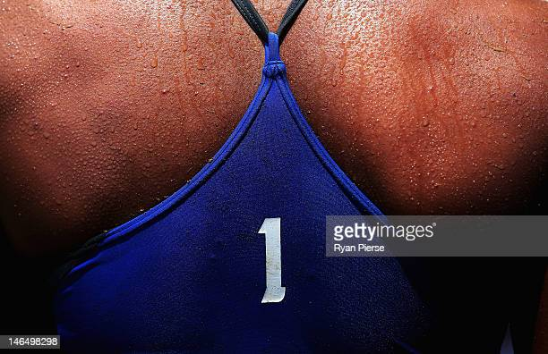 Sweat is seen on the back of Varapatsorn Radarong of Thailand during her Beach Volleyball Women's Gold Medal match with Tanarattha Udomchavee of...