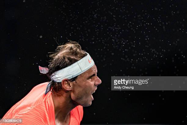Sweat is seen spraying from Rafael Nadal of Spain during his Men's Singles Quarterfinals match against Stefanos Tsitsipas of Greece during day 10 of...