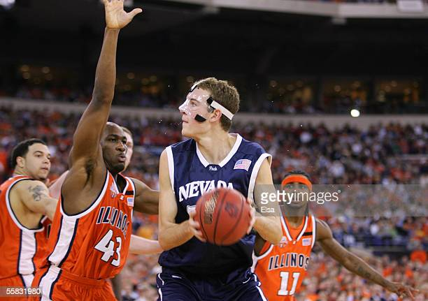 Sweat sprays off the head of Nick Fazekas of the Nevada Wolf Pack against Roger Powell Jr #43 of the Illinois Fighting Illini in the second round of...