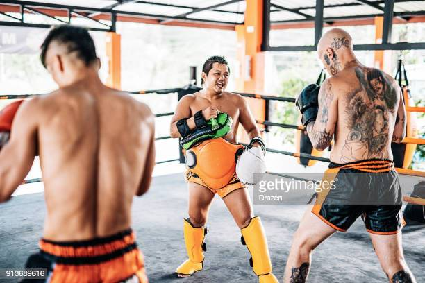 sweat your anger out or go home! - muay thai stock pictures, royalty-free photos & images