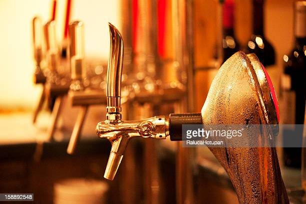 sweated beer tap in bar