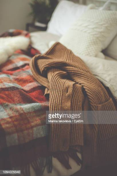 Sweater On Bed At Home