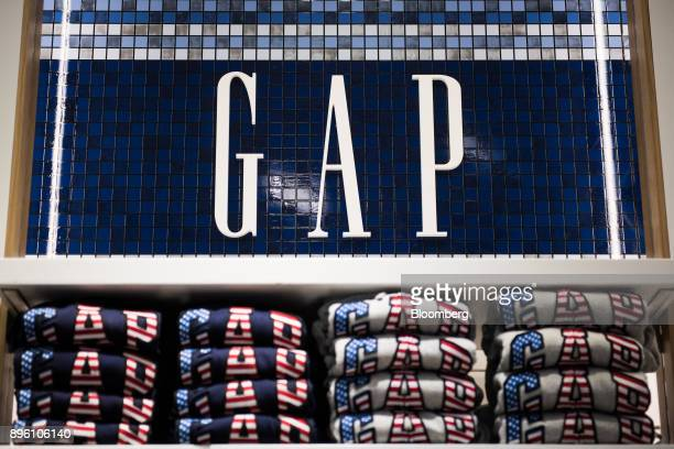 3218830b337 Sweaters are displayed for sale below signage at a Gap Inc store in New  York US
