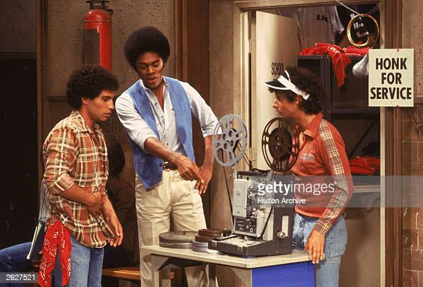 'Sweathogs' Robert Hegyes Lawrence HiltonJacobs and Ron Palillo examine a film projector in a still from the television series 'Welcome Back Kotter'...