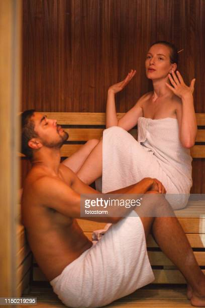 sweating in sauna - black woman in sauna stock pictures, royalty-free photos & images