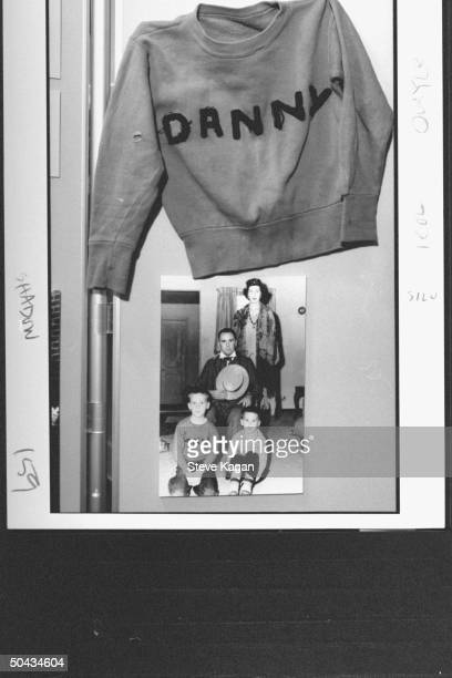 A sweatshirt w Danny sewn on it hanging above a 1950s Quayle family picture which includes Danny sporting the sweatshirt in The Dan Quayle Center...