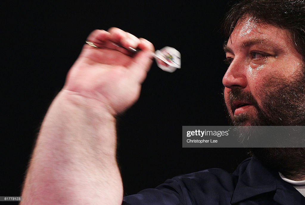 A sweaty Andy Fordham in action during the Showdown match against Phil Taylor at The Circus Tavern November 21, 2004 in Purfleet, England.