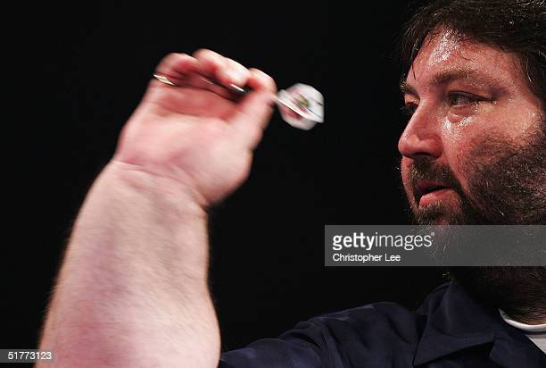 A sweaty Andy Fordham in action during the Showdown match against Phil Taylor at The Circus Tavern November 21 2004 in Purfleet England