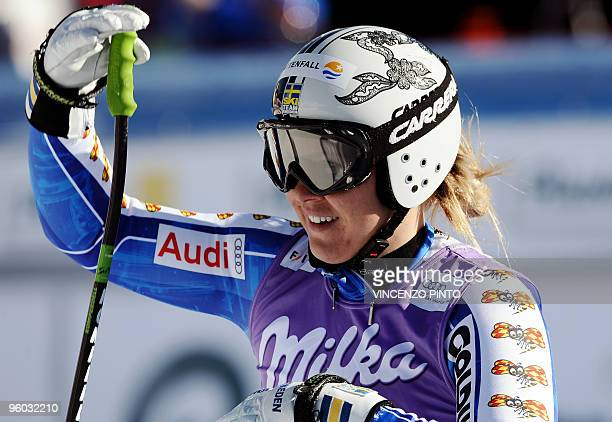Swede Anja Paerson reacts after crossing the finish line at the end of the women's World Cup ski downhill race in Cortina d'Ampezzo on January 23...