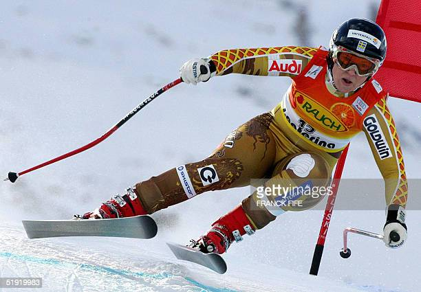 Swede Anja Paerson skis past a gate 05 January 2005 during the World Cup dowhnill in Santa Caterina Austria's Micheala Dorfmeister won the event...