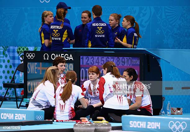 Sweden and Canada teams talk with their coaches during a break during the Gold medal match between Sweden and Canada on day 13 of the Sochi 2014...