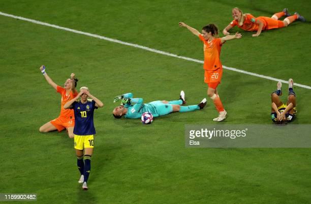 Sweden and Netherland players react on the finl whistle during the 2019 FIFA Women's World Cup France Semi Final match between Netherlands and Sweden...