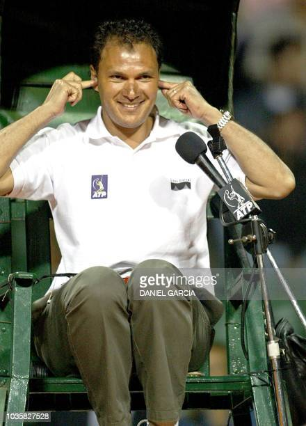 Sweden ATP's umpire Mohamed Lahyani reacts while the public boos him during the men's singles 2nd round between Argentinian José Acasuso and French...