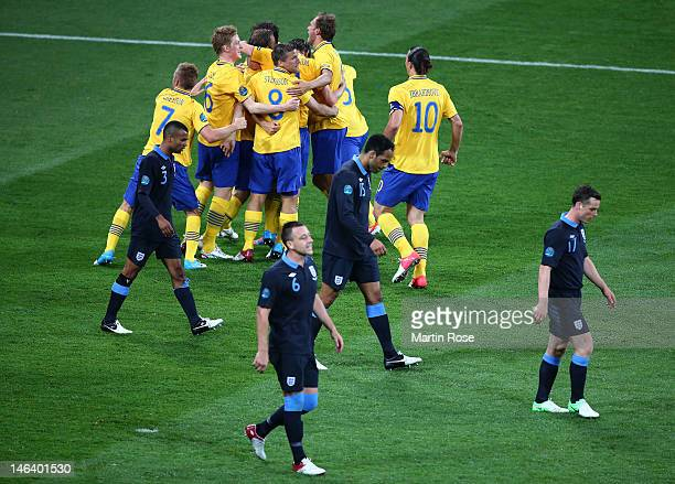 Sweden celebrate after Olof Mellberg of Sweden scored their first goal during the UEFA EURO 2012 group D match between Sweden and England at The...