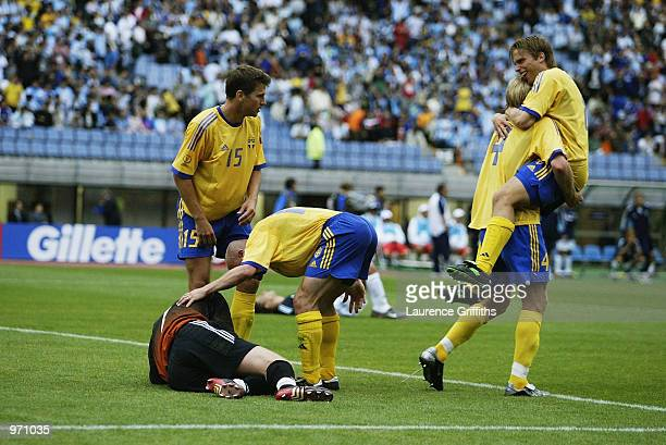 Sweden celebrate after the Argentina v Sweden Group F World Cup Group Stage match played at the Miyagi Stadium Miyagi Japan on June 12 2002 The match...
