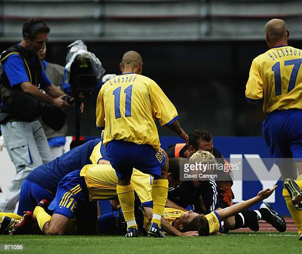 Sweden celebrate Anders Svensson's goal during the Argentina v Sweden Group F World Cup Group Stage match played at the Miyagi Stadium Miyagi Japan...