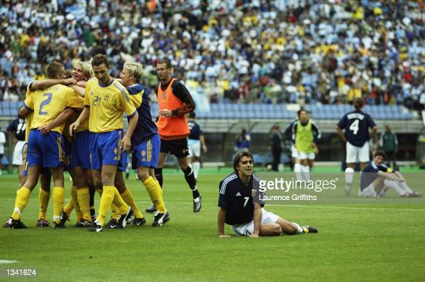 Sweden celebrate at the end of the Group F match of the World Cup Group Stage against Argentina played at the Miyagi Stadium Miyagi Japan on June 12...
