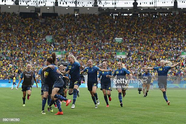 Sweden celebrate victory in the Women's Football Semi Final between Brazil and Sweden on Day 11 of the Rio 2016 Olympic Games at Maracana Stadium on...