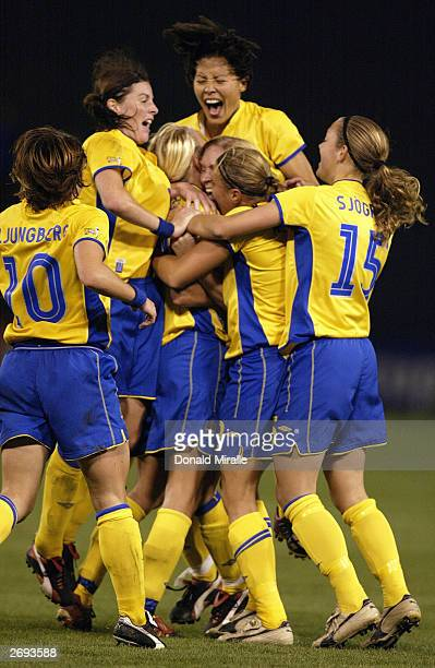 Sweden celebrates Josefine Oeqvist's goal over Canada during the semifinals of the FIFA Women's World Cup match on October 5 2003 at PGE Park in...