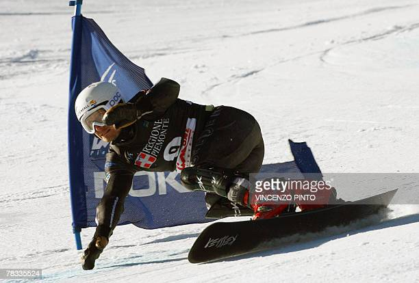 Sweden Daniel Biveson competes in the Men's parallel giant slalom snowboard World Cup race in Limone Piemonte 08 December 2007 Austrian Manuel Veith...