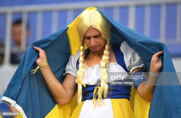 Sweden fan looks dejected following his sides defeat in the 2018 FIFA World Cup Russia Quarter Final match between Sweden and England at Samara Arena...