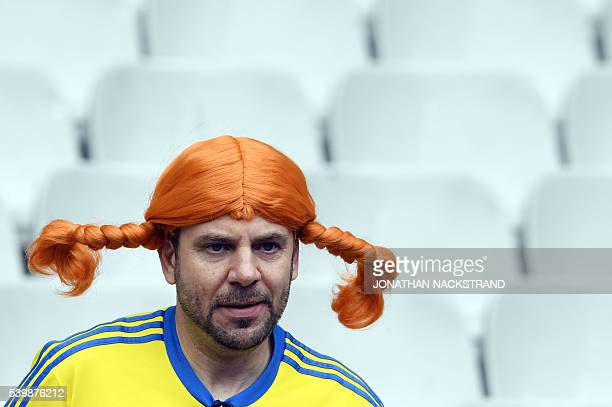 A Sweden fan sports a 'Pippi Longstocking' wig before the Euro 2016 group E football match between Ireland and Sweden at the Stade de France stadium...