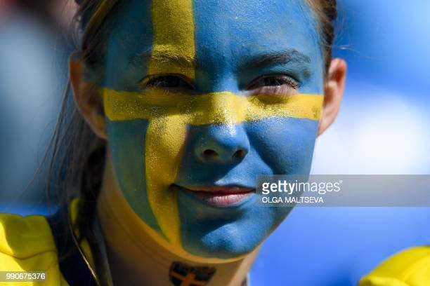 Sweden fan waits for the start of the Russia 2018 World Cup round of 16 football match between Sweden and Switzerland at the Saint Petersburg Stadium...