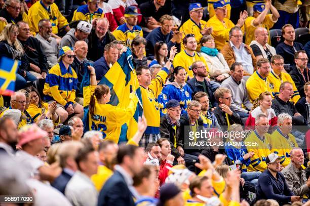 Sweden fans cheer during the group A match Russia v Sweden of the 2018 IIHF Ice Hockey World Championship at the Royal Arena in Copenhagen Denmark on...