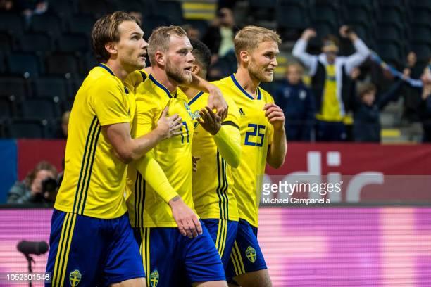 Sweden forward John Giudetti celebrates scoring the 10 goal with teammates Albin Ekdal Sebastian Andersson and Martin Olsson during the International...