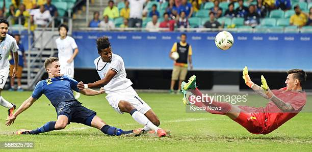 Sweden goalkeeper Andreas Linde makes a save on a shot from Japan striker Musashi Suzuki in the second half of their final group match at the Rio de...