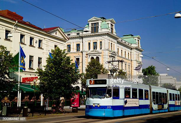 sweden, gothenburg, avenyn, tram travelling on city street - gothenburg stock pictures, royalty-free photos & images
