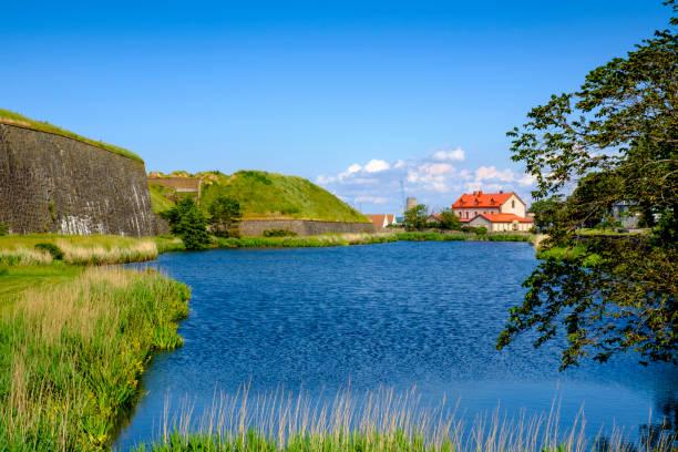 Sweden, Halland County, Varberg, Blue riverbank in summer