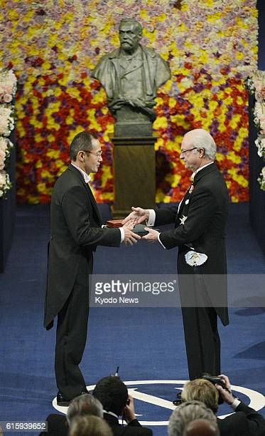 STOCKHOLM Sweden Japanese stem cell researcher Shinya Yamanaka a corecipient of the 2012 Nobel Prize in medicine receives his prize from Sweden's...