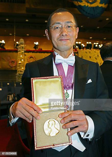 STOCKHOLM Sweden Japanese stem cell researcher Shinya Yamanaka a corecipient of the 2012 Nobel Prize in medicine shows his Nobel Prize medal after...