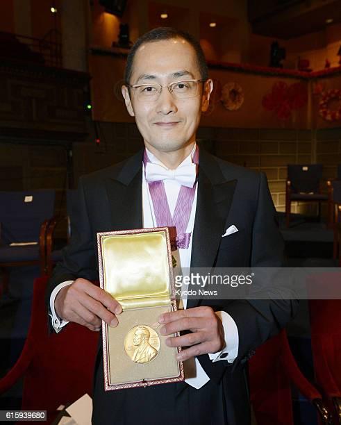 STOCKHOLM Sweden Japanese stem cell researcher Shinya Yamanaka a corecipient of the 2012 Nobel Prize in medicine shows his Nobel Prize medal after...