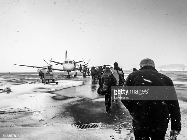 Sweden, Kalmar, Kalmar Airport, Passengers boarding small airplane in winter