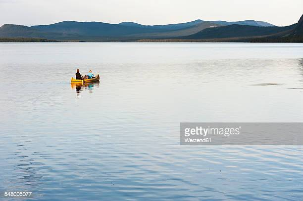 Sweden, Lapland, Norrbotten County, Kvikkjokk, canoeing father, daughter and son on lake Saggat
