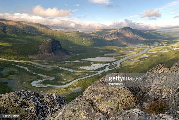sweden, lapland, rapa valley with the delta of the river rapaätno and skierffe-cliff including nammasj in the sarek national park - norrbotten province stock photos and pictures