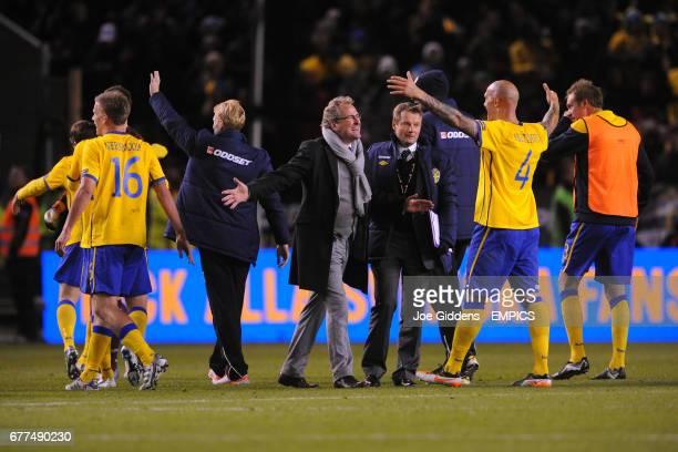 Sweden manager Erik Hamren celebrates with his player after ensuring qualification for Euro 2012