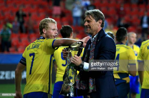 Sweden manager Hakan Ericson celebrates with the UEFA European Under21 Championship trophy
